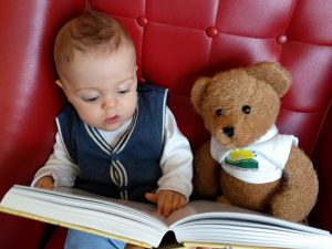 Henry reading to Oliver Bear